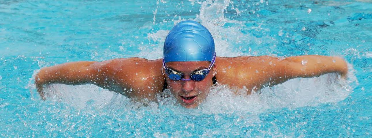 Senior Caroline Strolic spends hours in the water, practicing before and after school.