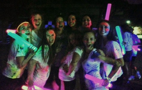 NDP students, from left, Rachel Blackbourn, Madeline Sobek, Erin Bradford, Mackenzie Spencer, Evelyn Medai, Kryssia Fernandez, Maya Patel, McKayla Tully, and Bridget Maguire glow in the dark at last year's first Neon Dance Party