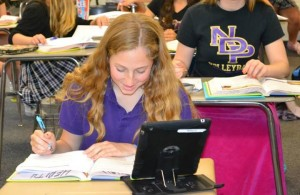 Freshman Alyssa Williams uses her iPad for a class assignment.