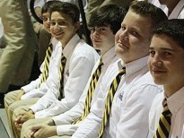 Students sport striped ties during the first Mass of the school year.