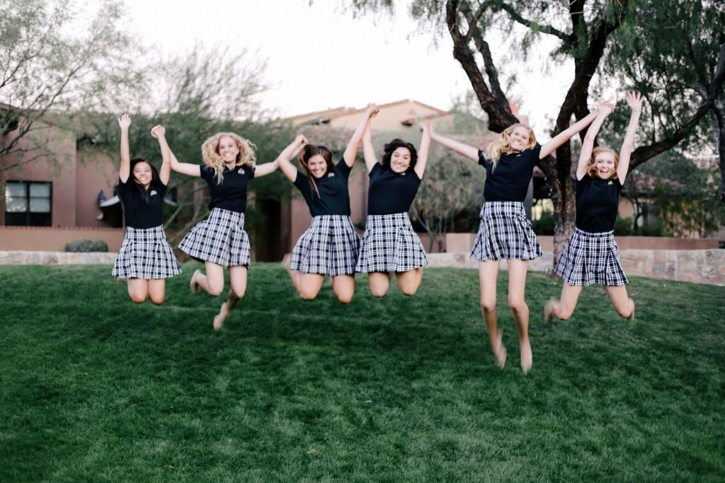 Notre+Dame+Preparatory+Seniors+jumping+in+their+black+polos.