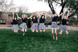 Notre Dame Preparatory Seniors jumping in their black polos.