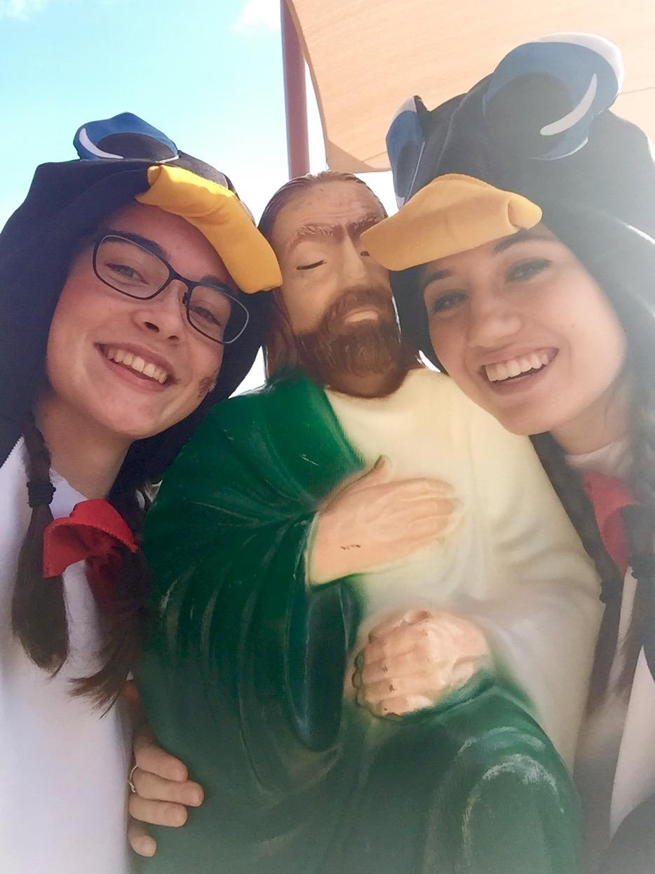 Cara Thompson and Allison Yeomans take a selfie with Touchdown Jesus.