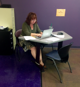 Ms. Julian submits grades for her AP Literature class.
