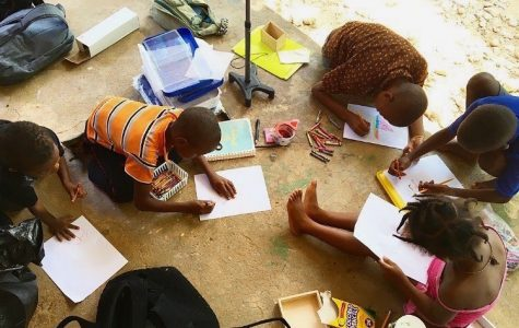 Haitian students draw pictures outside of school in this picture provided by the Bradford family.
