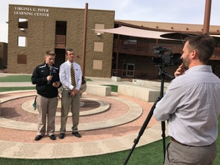 Jayce Henderson records Andrew Davis, left, and JJ Gresco during recent video announcement production.