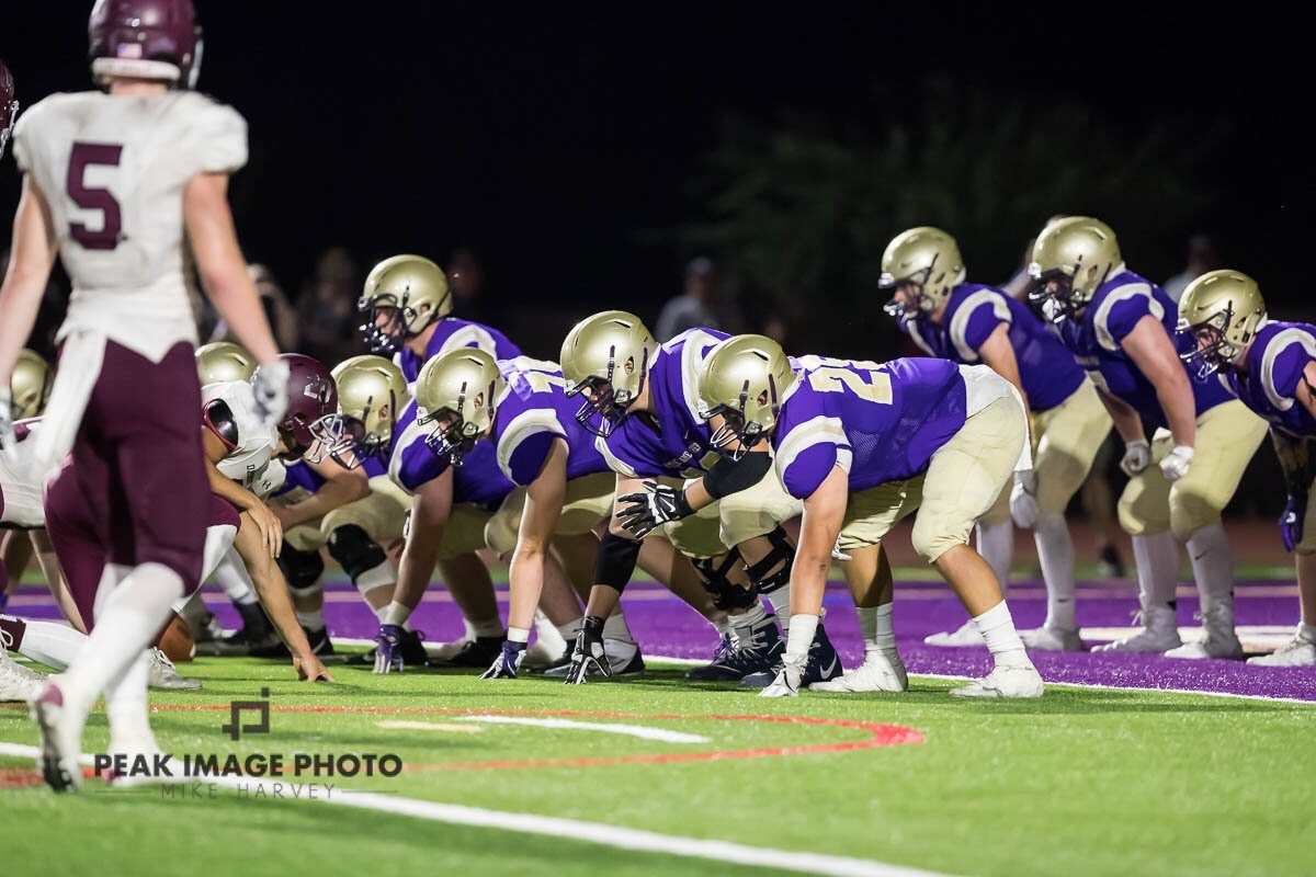 NDP lines up to defend against their rival, Desert Mountain (Mike Harvey/Peak Image Photo)
