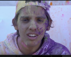 Joshua Babu, covered in colorful paint, for his Harvard application video (Jacob Staudenmaier/Special to The Seraphim)