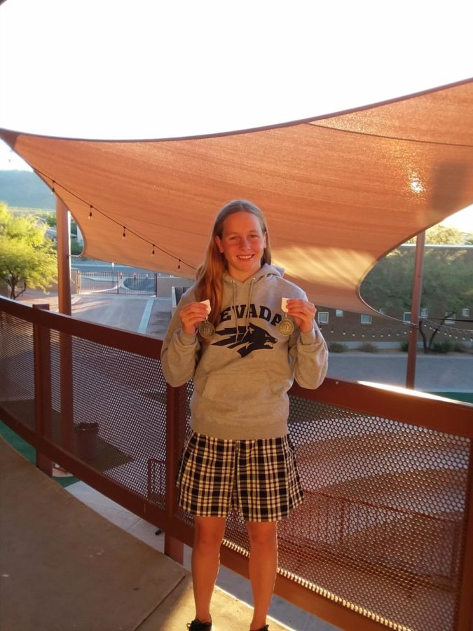 Senior+Alexa+Markl%2C+who+earned+a+swimming+scholarship+to+the+University+of+Nevada%2C+shows+her+state+swimming+medals+%28Theresa+Smith%2FThe+Seraphim%29