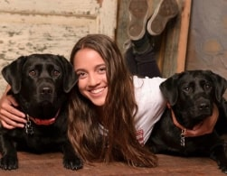 Senior Erin Nemivant with the dogs she is training for Power Paws. (Cilento Photography/Special to The Seraphim)
