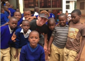 NDP senior Mason Stuart poses with the children he was helping in Tanzania (Mrs. Gjerstad/Special to the Seraphim)
