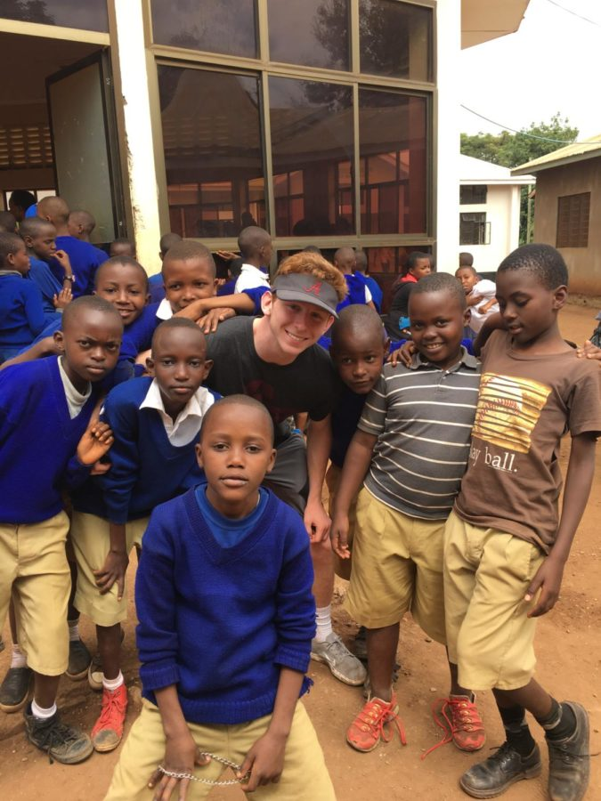 NDP+senior+Mason+Stuart+poses+with+the+children+he+was+helping+in+Tanzania+%28Mrs.+Gjerstad%2FSpecial+to+the+Seraphim%29