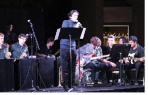 (From left) Matthew Tryon, Trevor Johnson, Sophie Kezirian, Ben Davis, Josh Babu, Eddie Eberle, Cole Streifel-Gollon, Reina Squires, and Paolo Rances, preform at the Fine Arts Festival (Kimberly Haub/Special to the Seraphim)