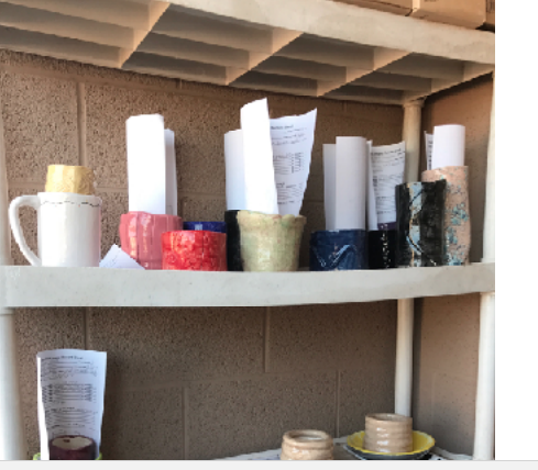 Shelf outside Mr. Medhus' classroom filled to the brim with student-made pottery (Rose Tuft/The Seraphim)