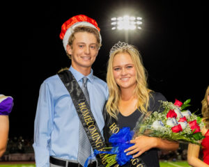 Seniors Jonathan Curran and Jordan Weaver accept their crowns as Homecoming king and queen during halftime Friday.