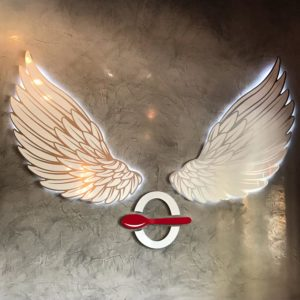 Zero Degrees logo pictured with wings and their recognizable O with a red spoon.