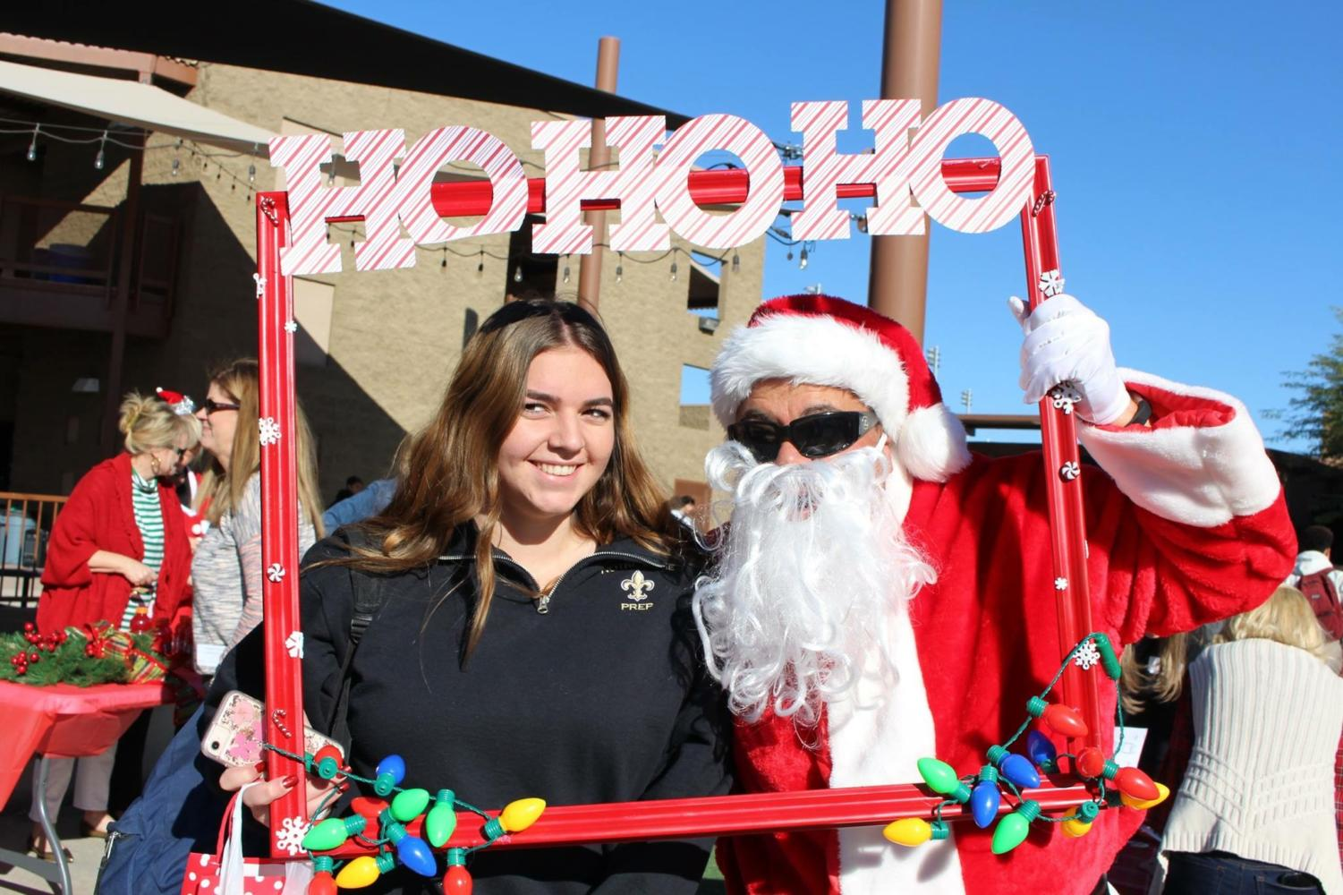 Senior, Izzy Sera, is pictured with Santa outside of the COMM last year.