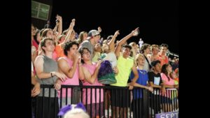 Notre Dame Preparatory students root for the football team on Bemis Field in order to remain undefeated on Sep. 6. The Saints cheered very loudly in their neon gear while playing Gilbert highschool.