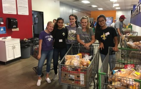 From left, Brooke Benson, Sheida Sadeghi, Abigail Murphy, Tia Mull and Casey Park pose for a photo during their freshman plunge at St. Mary's Food Bank in Phoenix. Photo courtesy of ndpsaints.org.